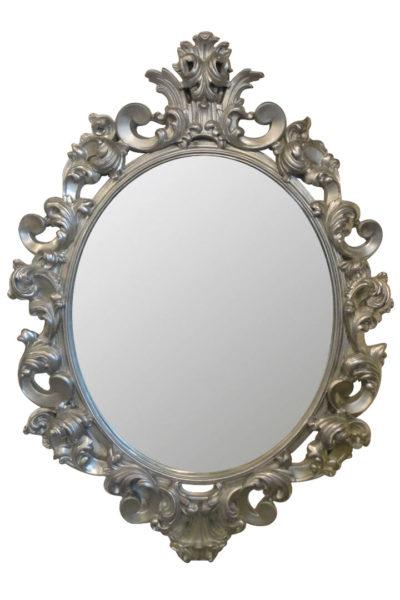 овальное зеркало в раме